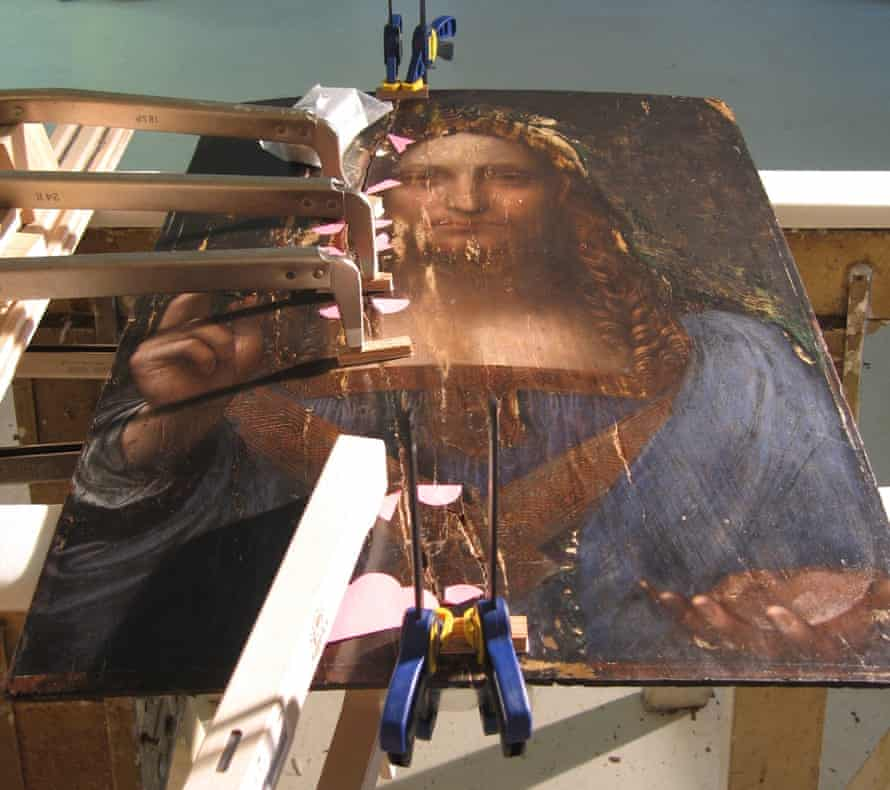 Cracked canvas … the work is shown being restored in The Lost Leonardo.